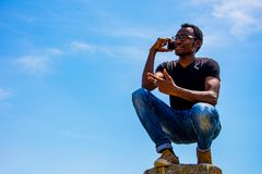 Young black business man. With glasses speaking on the phone Stock Images
