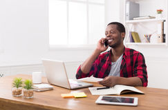 Young black businessman call mobile phone in modern white office Stock Images
