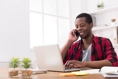 Young black businessman call mobile phone in modern white office Royalty Free Stock Photo