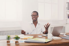 Young black businessman read documents in modern white office Royalty Free Stock Photography