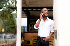Young black businessman talking on mobile phone Royalty Free Stock Image