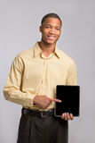 Young Black Businessman Texting on Touch Pad Royalty Free Stock Photo