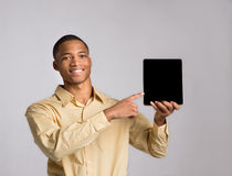 Young Black Businessman Texting on Touch Pad Royalty Free Stock Images