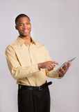 Young Black Businessman Texting on Touch Pad Stock Photo