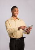 Young Black Businessman Texting on Touch Pad Royalty Free Stock Photography