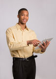 Young Black Businessman Texting on Touch Pad Stock Image