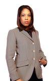 Young black businesswoman. Half body portrait of young black businesswoman with white studio background Royalty Free Stock Photo