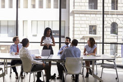Young black businesswoman addressing colleagues at a meeting royalty free stock photo