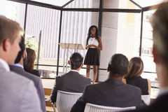 Young black businesswoman presenting seminar to an audience Royalty Free Stock Photo