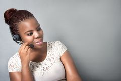 Young Black call center agent working, discussing Stock Photography