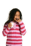 Young black child enjoying cupcake Royalty Free Stock Photography