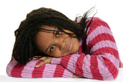 Young black child with head on arms Stock Images
