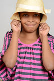 Young black child silly with hat Stock Images