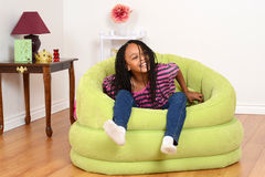 Young black child trying to get out of chair royalty free stock photo