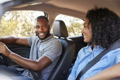 Young black couple in a car looking at each other smiling Royalty Free Stock Images