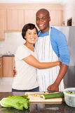 Young black couple cooking royalty free stock photography