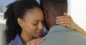 Young black couple embracing each other. At home Stock Images