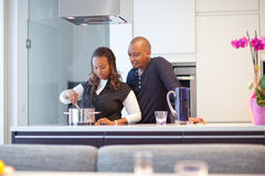 Young black couple in kitchen Royalty Free Stock Image