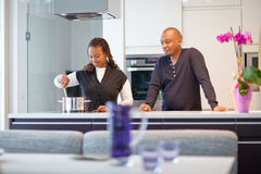 Young black couple in kitchen Royalty Free Stock Images