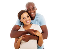 Young black couple. Lovely young black couple looking at the camera on white background Royalty Free Stock Image