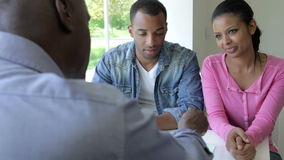Young Black Couple Meeting With Financial Advisor At Home stock footage