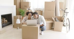 Young black couple moving into their new home stock footage