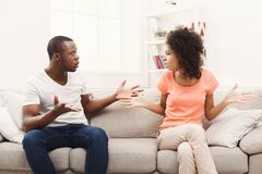 Young black couple quarreling at home. Young african-american couple quarreling at home, offended at each other . Family relationship difficulties concept Stock Photos