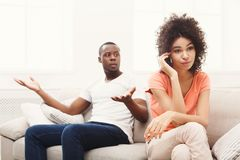 Young black couple quarreling at home. Young african-american couple quarreling at home, women offended. Family relationship difficulties concept Royalty Free Stock Photography