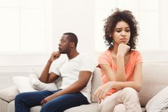 Young black couple quarreling at home. Young african-american couple quarreling at home, women offended. Family relationship difficulties concept Stock Photos
