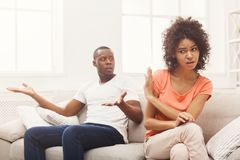 Young black couple quarreling at home. Young african-american couple quarreling at home, women offended. Family relationship difficulties concept, copy space Royalty Free Stock Photos