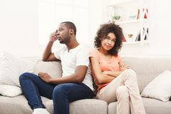 Young black couple quarreling at home. Young african-american couple quarreling at home, offended at each other . Family relationship difficulties concept Royalty Free Stock Image