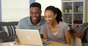 Young black couple watching funny video on laptop Royalty Free Stock Image