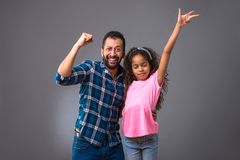 Young black dad with his daughter. A young black men standing with his daughter and they celebrater Royalty Free Stock Image