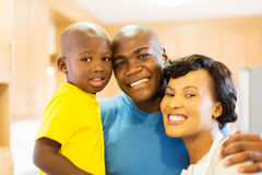 Young black family. Close up portrait of cheerful young black family royalty free stock images