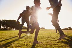 Free Young Black Family Playing In A Field In Summer Stock Image - 99965741