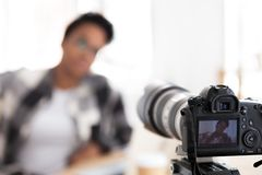 Young black female blogger on camera screen stock photography