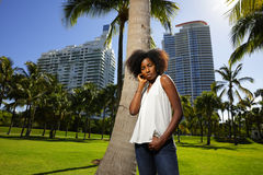 Young black female posing by a tree in the park Stock Photo