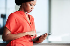 Young black female student using digital tablet in modern environment Royalty Free Stock Photos