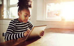 Young black girl browsing on a tablet-pc Royalty Free Stock Photography
