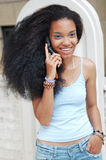 Young black girl on cellphone Royalty Free Stock Images