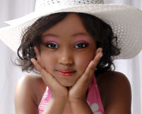 Young Black Girl Kindergarden. Cute black girl with attitude wearing a hat Royalty Free Stock Photography