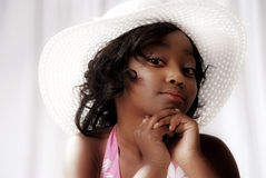 Young Black Girl Kindergarden. Cute black girl with attitude wearing a hat Royalty Free Stock Photo