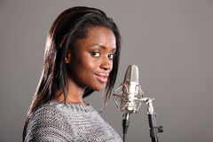 Young black girl making music in recording studio Stock Image