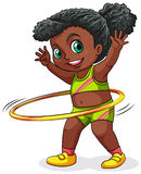 A young black girl playing with the hulahoop Royalty Free Stock Image