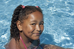 Young black girl in swimming pool Royalty Free Stock Image