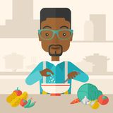 Young black guy is eating salad for lunch in the Royalty Free Stock Photos