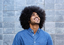 Young black guy laughing and looking up Stock Photo