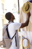Young black guy shopping outside Stock Photos