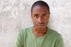 Young black guy staring. Close up portrait of young black guy staring Royalty Free Stock Images