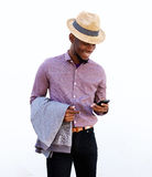 Young black guy using mobile phone Stock Image